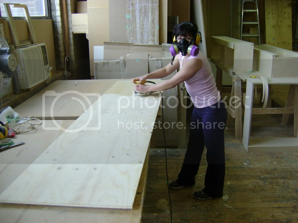 Heather sanding the salvage pine panels.